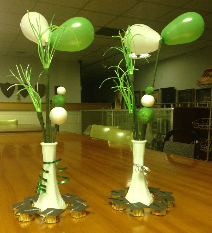 Open house centerpieces bud vase containing dowels with