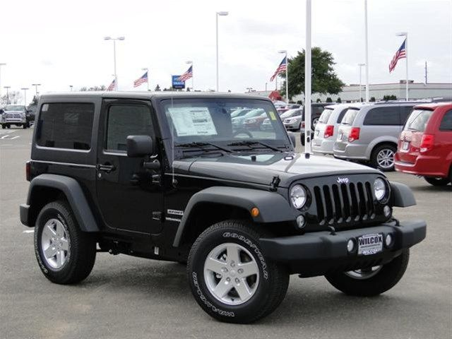 black jeep wrangler 2014...wish they would make a non gas gussler version sigh one day this will be mine
