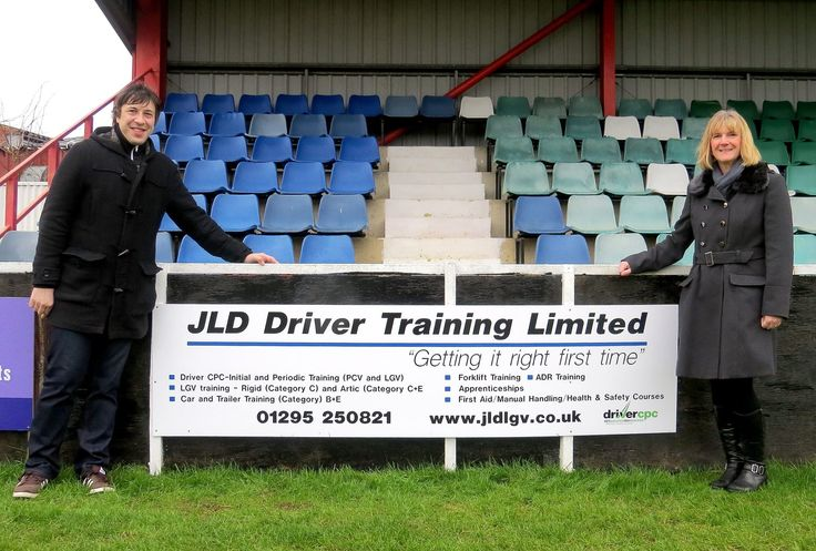 Lisa Dixon Managing Director of JLD Driver Training and Mark Allitt Commercial Director at Banbury United, pictured with the sponsorship board at Banbury United Stadium.  Lisa Dixon said 'JLD Driver Training are only too happy to support local business in the area the staff and team at Banbury United are extremely grateful for the support local business have provided over the last year. JLD Driver Training wish Banbury United every success with this seasons campaign.