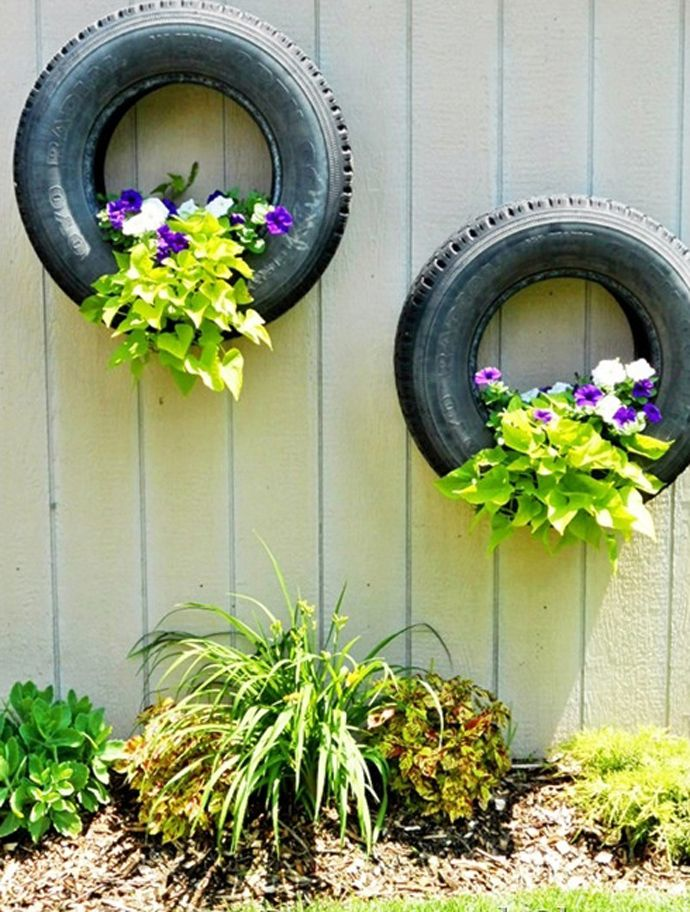 Reuse And Recycle Old Tires into outdoor wall planters. Be sure to drill a few drainage holes.