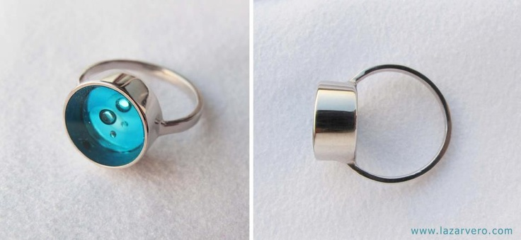 glass ring with moving bubbles and diamond