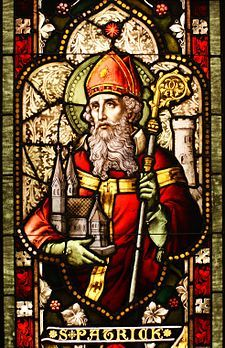 Irish: St. Patrick depicted in a stained glass window. Wearing of the green.