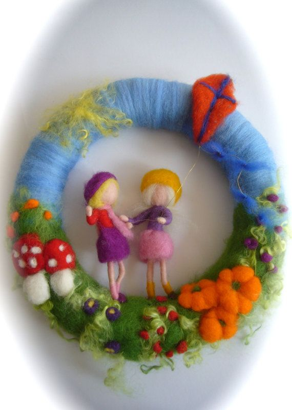 This wreath with 2 girls with a kite is Needle Felted. Average Diameter:11 Your purchase will be sent within 5/10 business days. If you need