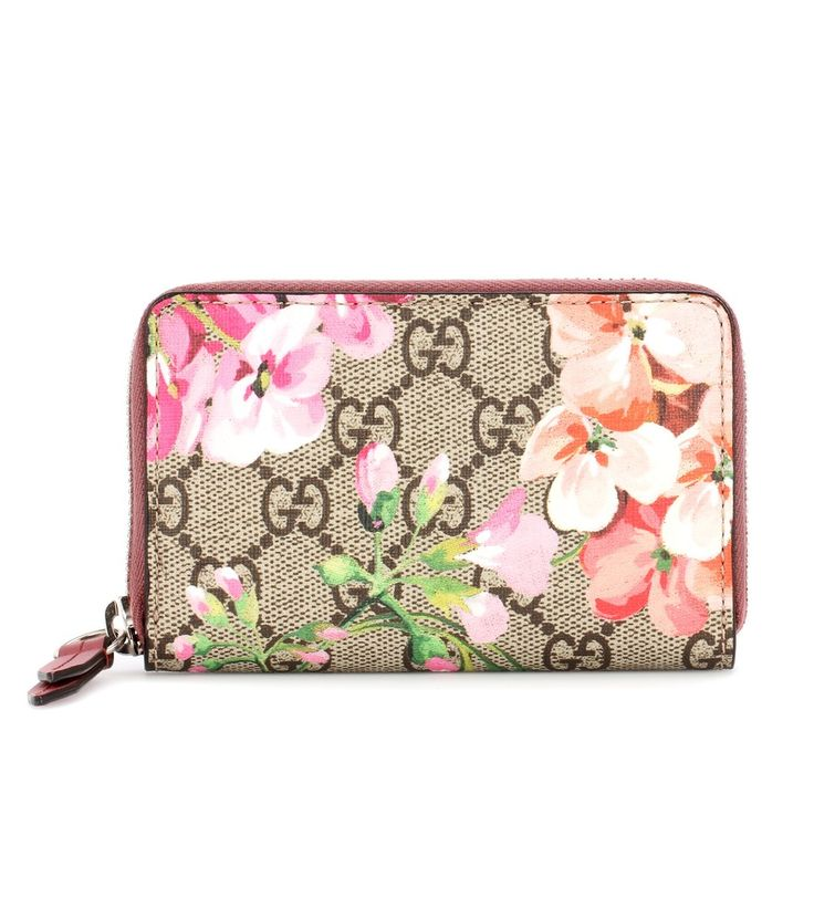 Gucci - Blooms GG Supreme printed canvas wallet - Gucci's Blooms GG Supreme wallet will bring a fresh, springtime feeling to your accessories edit. Beautiful pink geraniums stand out against the label's iconic 'GG'-printed canvas, while a silver-tone zipper and pink trimming finishes it on a luxe note. Use it to organise your essential cards within your larger tote for busy days on the go. seen @ www.mytheresa.com