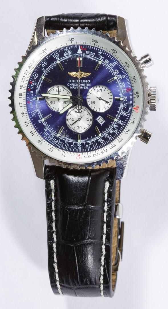 Lot 530: REPLICA Breitling Chronometre Navitimer Men's Wrist Watch; Having a blue face; ** This is a REPLICA watch **
