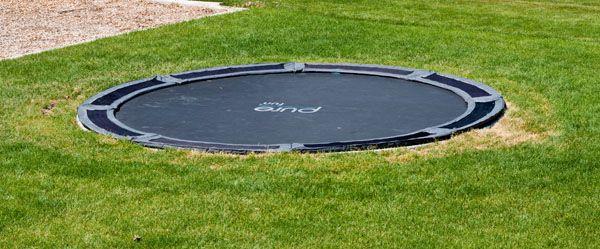 Vented trampoline pads for underground trampoline