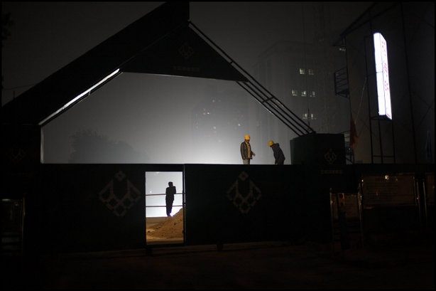 BEIJING—Migrant workers working at night on a construction site, 2006.  © Patrick Zachmann / Magnum Photos