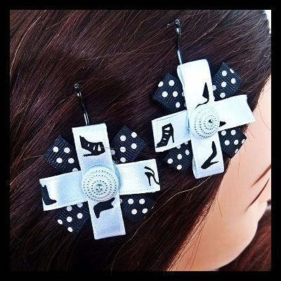 Black and white polka dot ribbon with high heel print ribbon on bobby pins. Step out wearing this gorgeous set of bobby pins featuring high heel print ribbon accentuated with a white and silver centrepiece. 8 Sets Available. $7.50 per set.