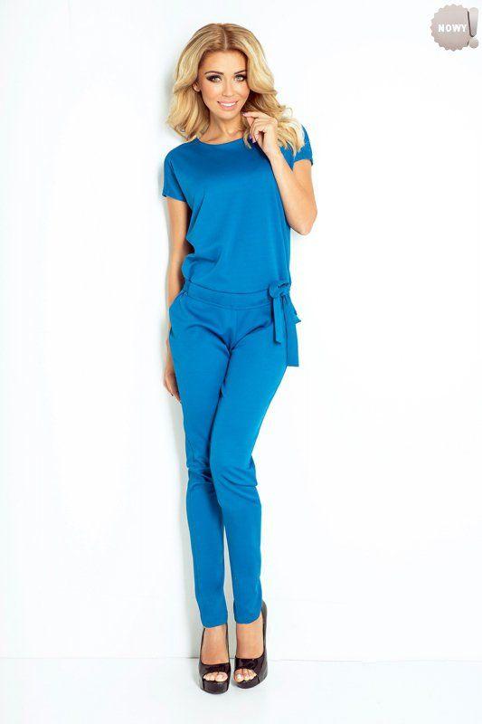 Elegancki, niebieski kombinezon damski, uszyty z przyjemnej w dotyku tkaniny Lacosta. #kombinezon #spodnie #długie #eleganckie #niebieski #kobieta #moda #trendy