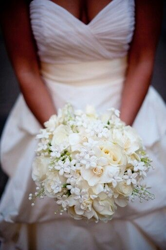 I love the all white look of this bouquet. The small white flowers I really want to incorporate. This looks so delicate, love.