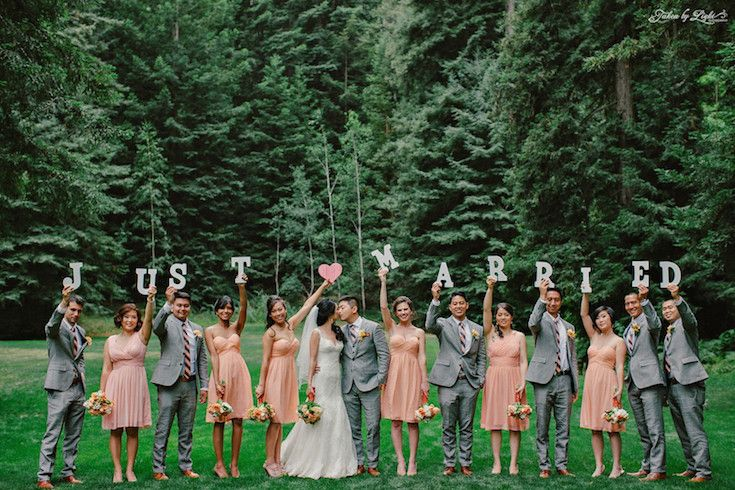 """Just Married!"" sweet bridal party photo - the peach bridesmaids dresses work really well with the guy's grey suits."