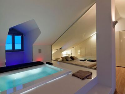 How about this? A hot tub in your loft for you to lie back and relax.