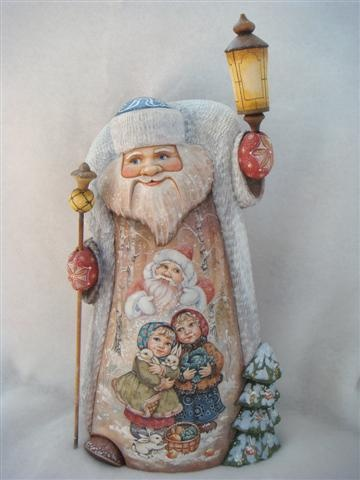 enormous hand carved wooden Russian Santa with hand painted pictures of little Russian children