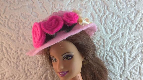 Pink felt hat for Barbie decorated with pink roses and a