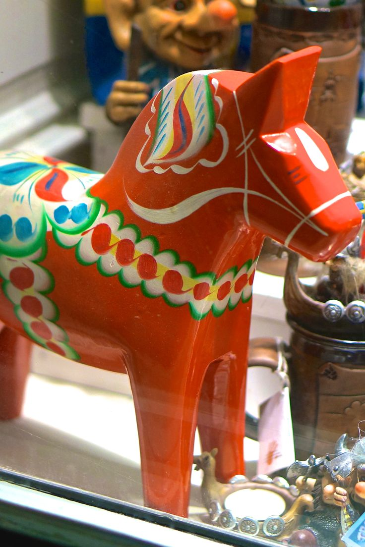 The iconic Swedish dala horse-- a fantastic travel souvenir from Sweden and the perfect pop of color to decorate a room. Where to shop for them in Stockholm.