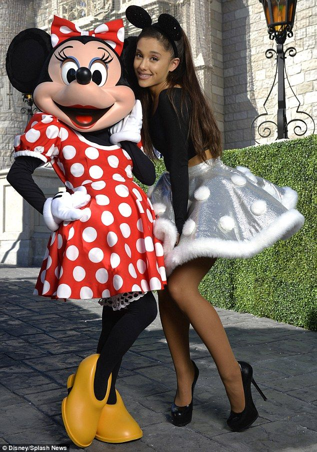 I like your style! Ariana dazzled in a black, long-sleeved crop top, a short and silver full skirt complete with white, fluffy polka dots