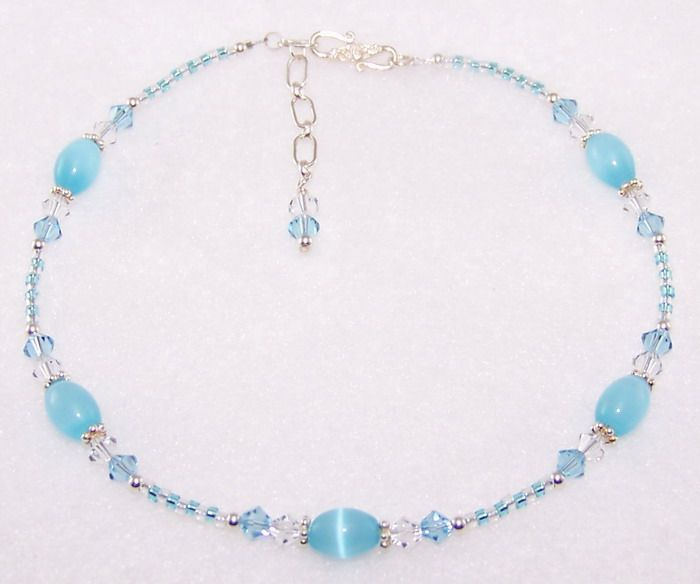 """""""Baby Blue"""" handmade beaded anklet.....Sri Lanka Opal rice beads, Swarovski crystals, glass seed beads, sterling silver spacers, sterling silver beads and findings and a sterling silver clasp."""