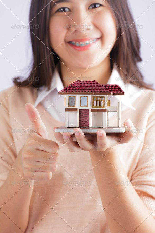Woman holding little house ... agent, architecture, background, broker, build, building, business, buy, concept, construction, estate, family, finance, hand, hands, hold, holding, home, house, insurance, investment, little, loan, model, mortgage, new, offer, property, purchase, real, rent, residential, sale, security, sell, selling, service, small, symbol, white, woman Jim Pellerin