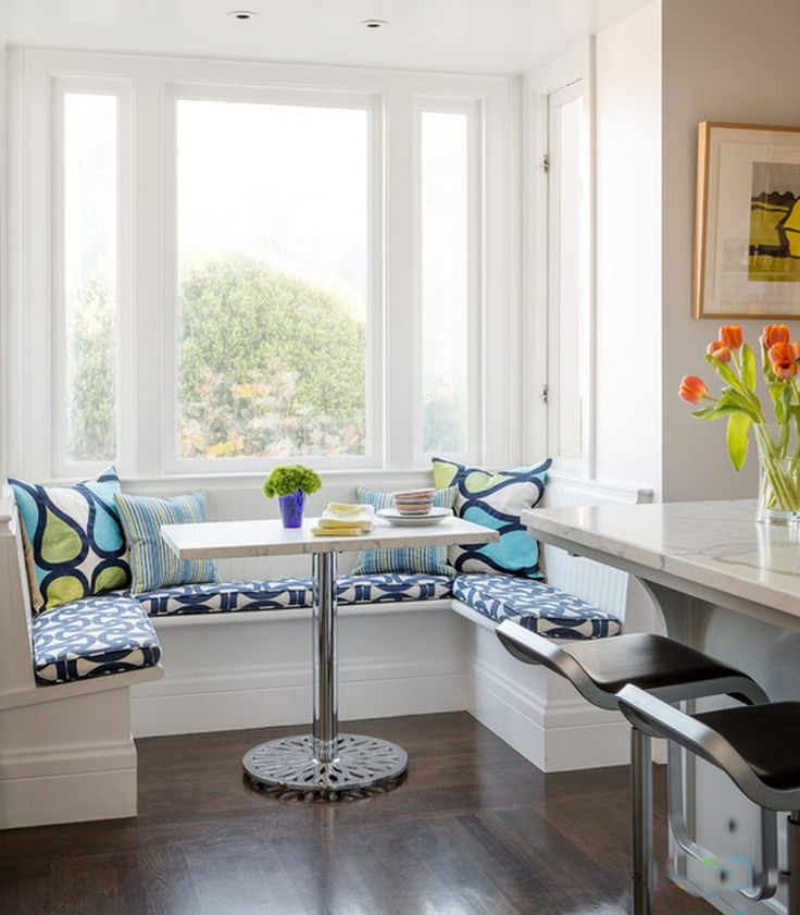 Furniture, Cool U Shaped White Kitchen Nook With Pattern Cushions Multicolor Cushions Small Rectangular Dining Table With Stainless Steel Leg White Glass Bay Window Dark Wood Floor: Knowing Best Kitchen Nook Ideas