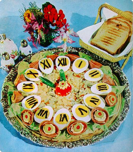 Hardboiled egg clock party platter, featuring olive and bologna rosettes: just perfect for New Year's Eve, when your guests are three sheets to the wind and have no idea what they're eating
