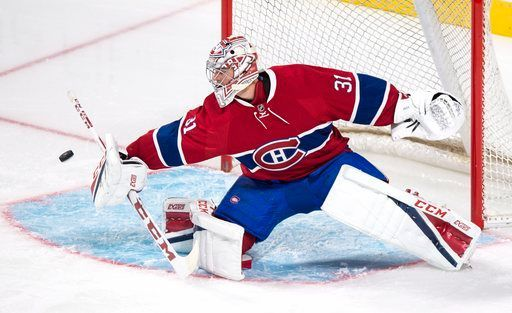 Montreal Canadiens goalie Carey Price deflects a Toronto Maple Leafs shot during the first period of an NHL hockey preseason game, Thursday, Oct. 6, 2016, in Montreal. (Paul Chiasson/The Canadian Press via AP)
