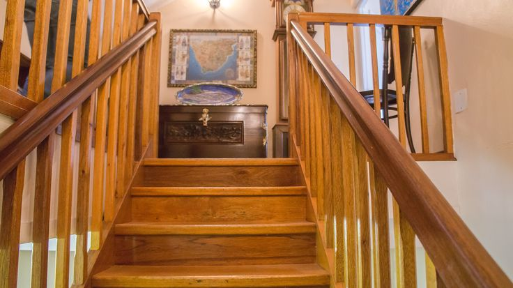 Staircase leading to the upper level of this home.