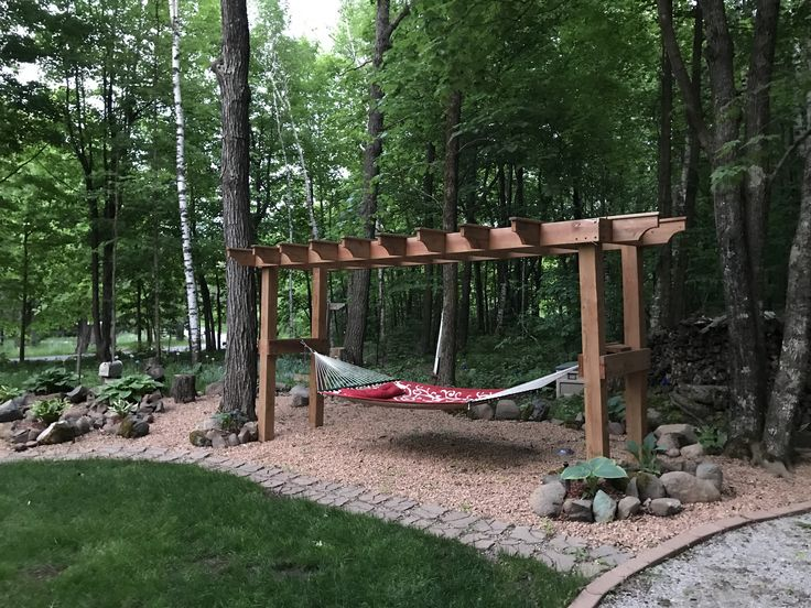 DIY pergola/hammock stand. Built out of cedar tone treated lumbar. Legs are 6*6 and uppers are double 2*8's for strength.  A perfect place to relax with the fur babies and my husband. Updated, rock bed and hostas added for tranquility. And less mowing and weed wacking.