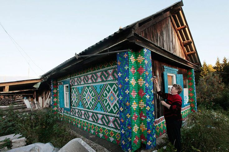 Olga Kostina has turned her modest home, in the rural town of Kamarchaga in the Siberian taiga, into quite the landmark. Inspired by traditional macrame motifs, the Russian pensioner has individually nailed over 30,000 plastic bottle caps to create pixelated patterns.