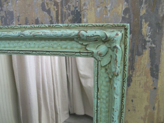DIY idea to paint gold mirror frame:  -Lightly distressed TeaStainedAqua finish with bits of the original gold peeking through.    detailed vintage frame made of wood with gesso detailing.       -Looks like the type of mirror that would have been hanging in a dark, smoky french bistro for decades    -Hanging wire attached.    -Perfect addition to your Shabby Cottage / Romantic Villa / French Country / Beachside style
