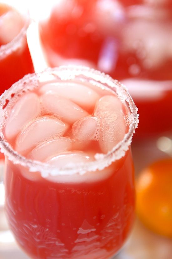 Christmas Mocktails: 4 cups cranberry juice 2 cups pineapple juice 2 cups orange juice ice sprite or sparkling water {optional} sugar, for glass rims