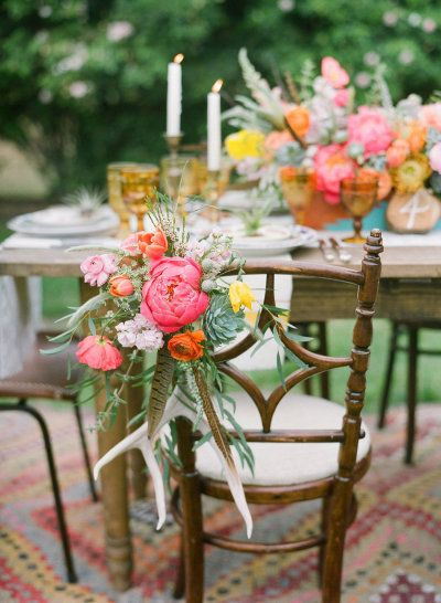 peonies, ranunculus and feathers decorating the seats | Photography by brycecoveyphotography.com |  Coordination, Design + Paper Design by bashplease.com | Floral Design by primarypetals.squarespace.com |   Read more - http://www.stylemepretty.com/2013/07/30/ojai-wedding-inspiration-from-bash-please-primary-petals-bryce-covey-photography/