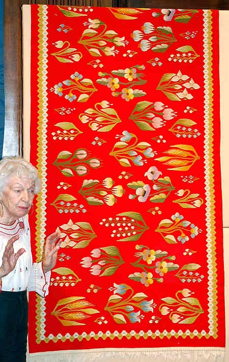 """Christine Brown on Romanian Textiles: kilim. The weaving is slit tapestry, but the curves in the designs in its field are accomplished with """"eccentric wefts.""""  In her discussion of eccentric wefts, Marla Mallett, in her book, Woven Structures, indicates that their use suggests """"an extremely stable warp, held under excellent tension.""""  Marla also notes that """"shallow, curved shapes are easily created,"""" when a weavers is employing slit tapestry."""