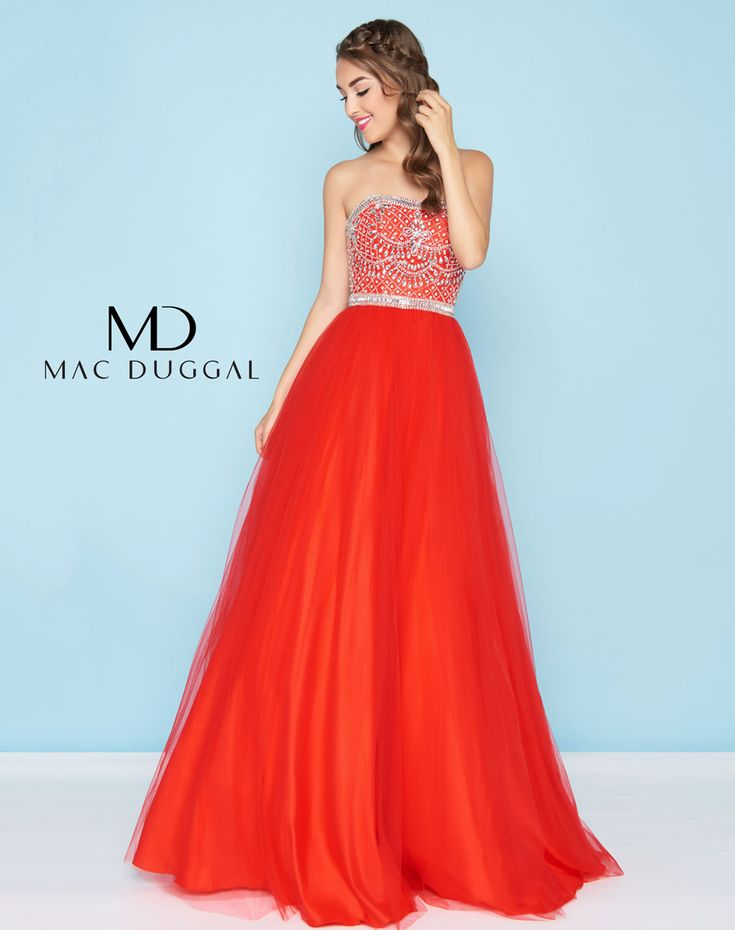 Strapless gown with beaded bodice and waist giving way to an a-line tulle skirt.