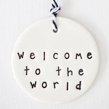 'welcome to the world' circle clay gift tag  www.carolinec.com.au