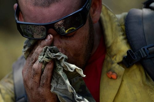 Yesterday - Hot Shot firefighter Chris Loung wipes sweat from his face while cutting a fire line in the Mount Saint Francois area of Colorado Springs.Hot Shots, Mount Saint, Colorado Springs, Afp Photos, Francois Area, Chris Lounges, Fire Fighter, Lounges Wipes, News Photos