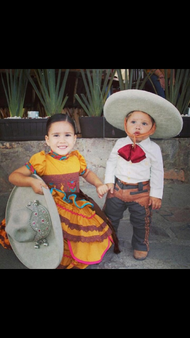 :) charro y escaramuza ~ que bella parejita.. All children are beautiful but we especially enjoy the Mexican children wearing traditional clothing - for more of Mexico visit www.mainlymexican... #Mexico #Mexican #girls #children #beauty