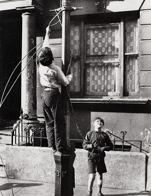 Making a swing rope from the old gas lanterns 1950's. I think that the photo is copyright of Roger Mayne