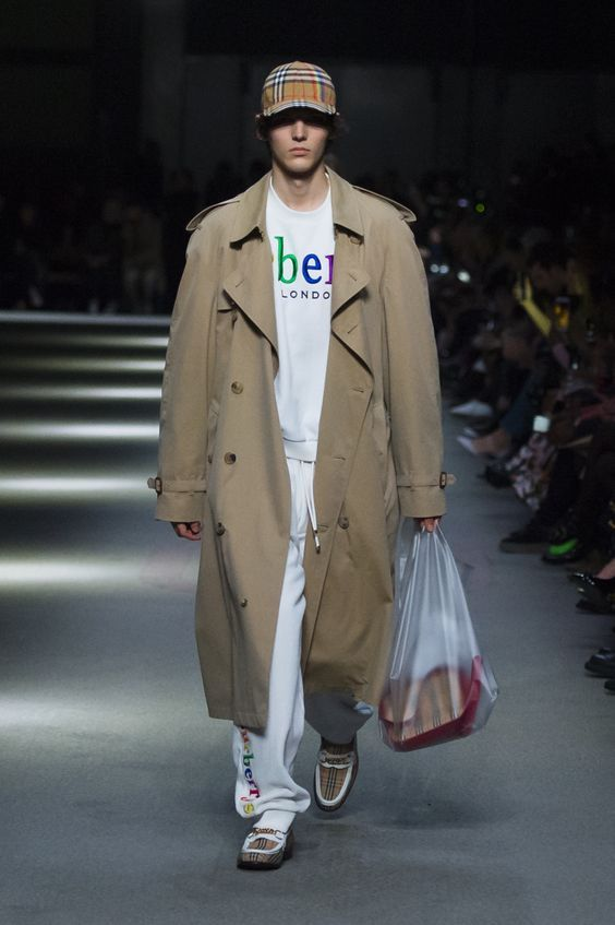 Gabardine trench coat with an archive logo towelling sweatshirt and sweatpants, #Rainbowcheck baseball cap and 1983 check loafers #BurberryShow #LFW