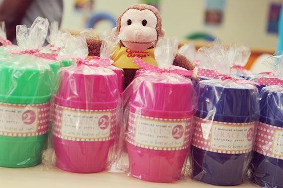 A very pink Curious George birthday party | TheMombot.com. barrel of monkey favors
