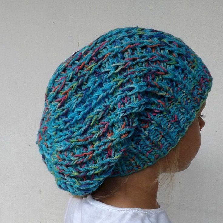 čepice-+veselá+Pletená+čepice+alá+pytel.+Materiál-+akryl,+bavlna.+Barva-+převládá+modrá,+dále+žlutá,+oranžová,+růžová,+fialová,+zelená.+Velikost-+uni.