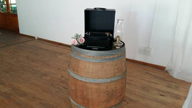 Rustic, vintage wedding. Roses, Baby's breath. Hessian, Burlap. Oil lamps. Typewriter. Event planner   Wedding planner   Florist   Floral designer   Cape Town