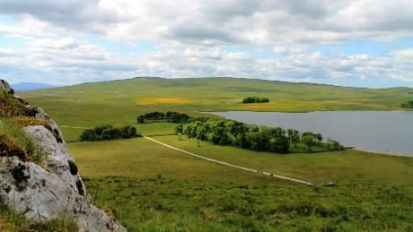 The hay meadows in the distance provide a nice splash of colour Malham Tarn, Yorkshire