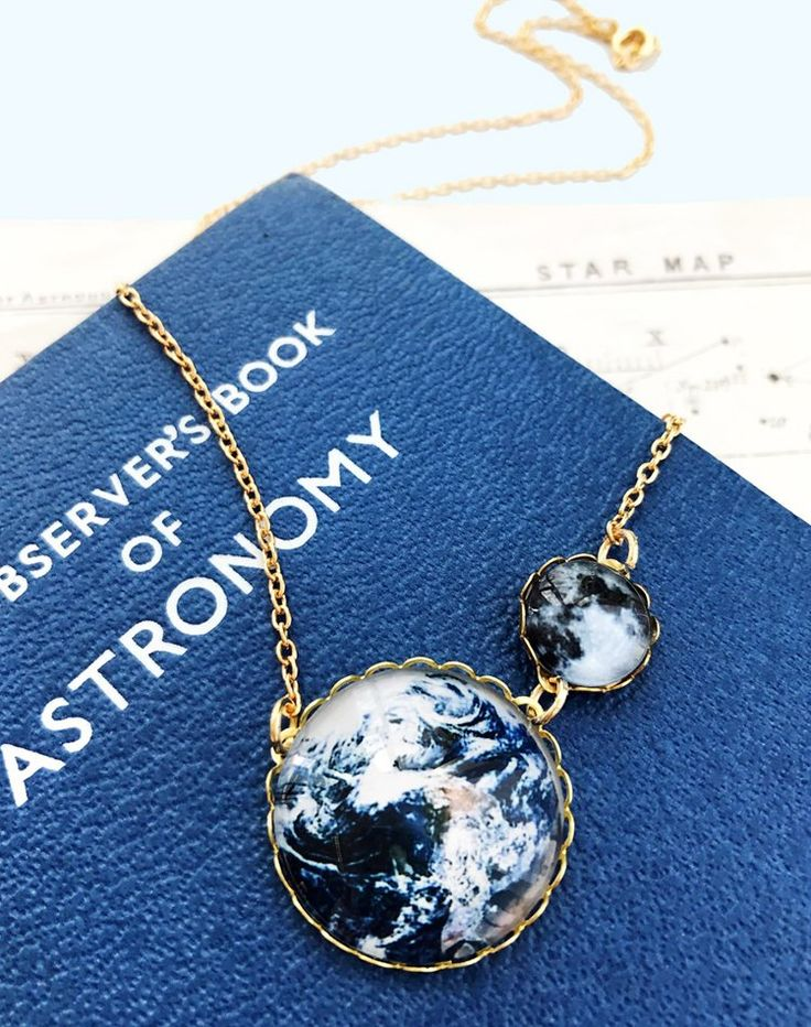 Go into orbit with this out-of-this-world necklace! A small glass Moon orbits around its accompanying Earth stone; the perfect wear-anywhere kind...