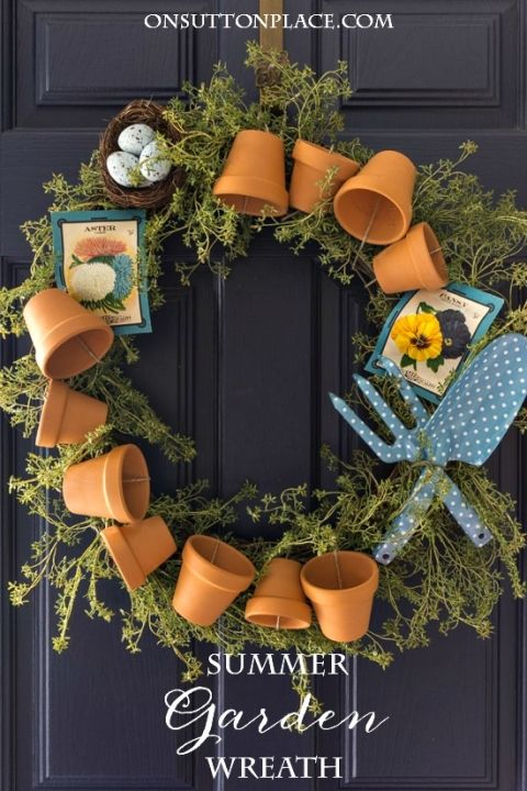 DIY Summer Garden Wreath | Easy tutorial with pictures. Includes how to attach the terra cotta flower pots. Perfect for your summer front porch!