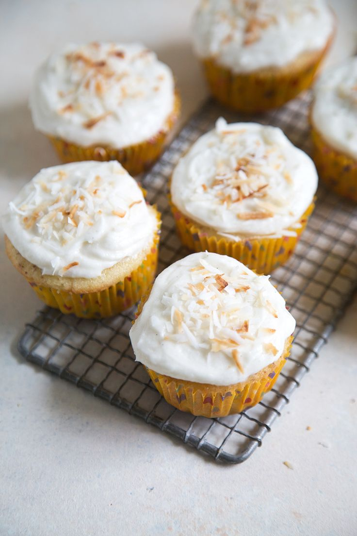 If you're looking for cute and creative cupcake ideas for a birthday party or a summer event, look no further. This is one of our favorite cupcake recipes of all time, because it takes a simple vanilla-bean cupcake recipe and adds pineapple and coconut on top for decoration.