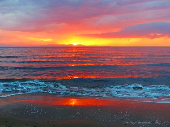 Sunset on a Maremma Tuscany beach after the rain: Torre Civette beach Punta Ala