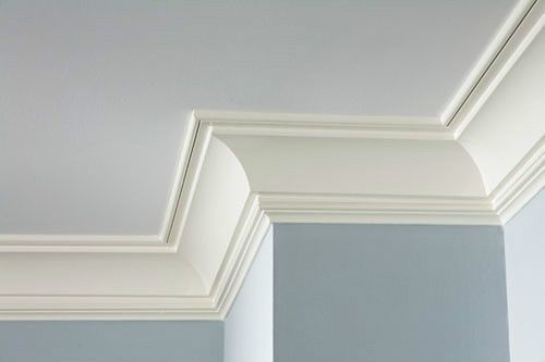 To make the ceiling appear higher is to use a coved crown moulding and then apply another piece of moulding on the ceiling.