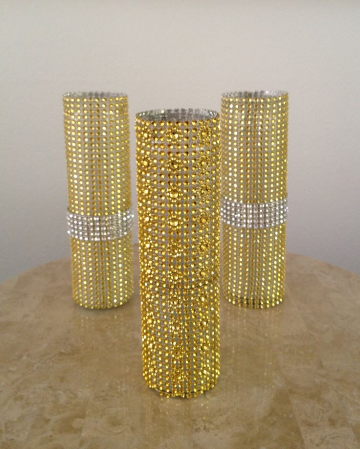 gold and silver bling vases.