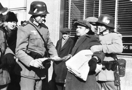 Fake Nazis attacked Henry Weppler, a newspaper seller for the Winnipeg Free Press, and ripped up his papers. It was part of a huge staged invasion in Winnipeg on Feb. 19, 1942 called IF Day, designed to scare people into donating money to Victory Loans.