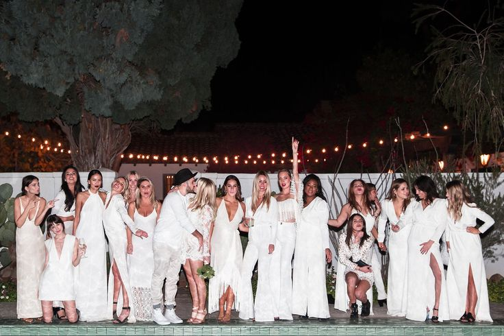 """DREAM WEDDING. """"Our guests wearing all white ended up being such an amazing element of the night, because it created camaraderie. Plus, it was the middle of winter, so everyone was excited to dress like it was summer, especially our East Coast friends."""""""